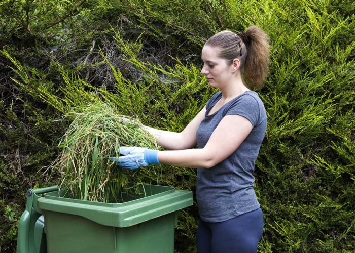 Lady throwing green waste